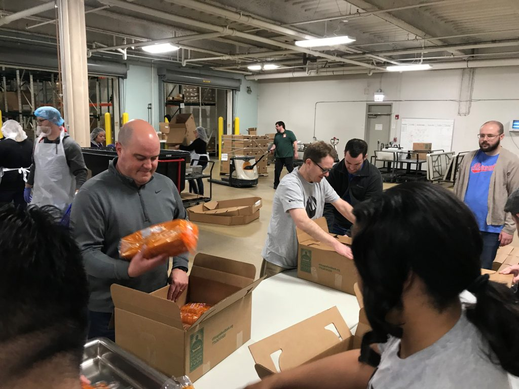 Barcodes Volunteers at the Greater Chicago Food Depository sorting and packaging bread.