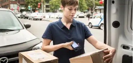 Honeywell's ScanPal EDA51 mobile computer scanning a package ready for delivery