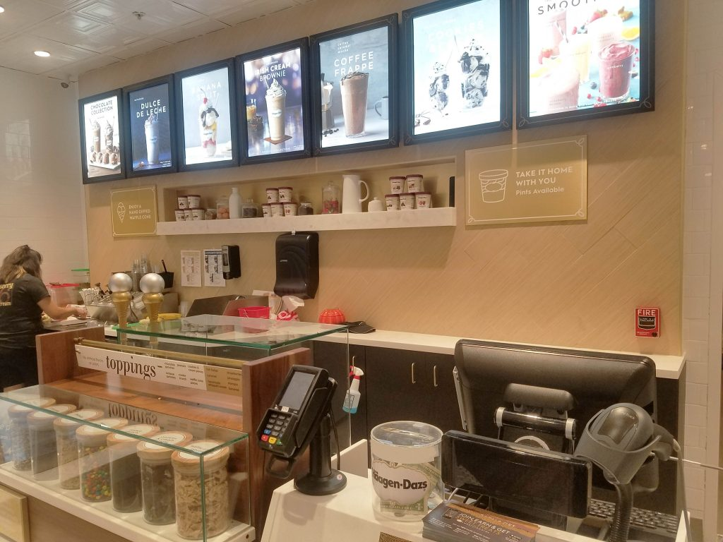 Airtrack S2 2D barcode scanner at Haagen Dazs checkout counter to improve scanning process.